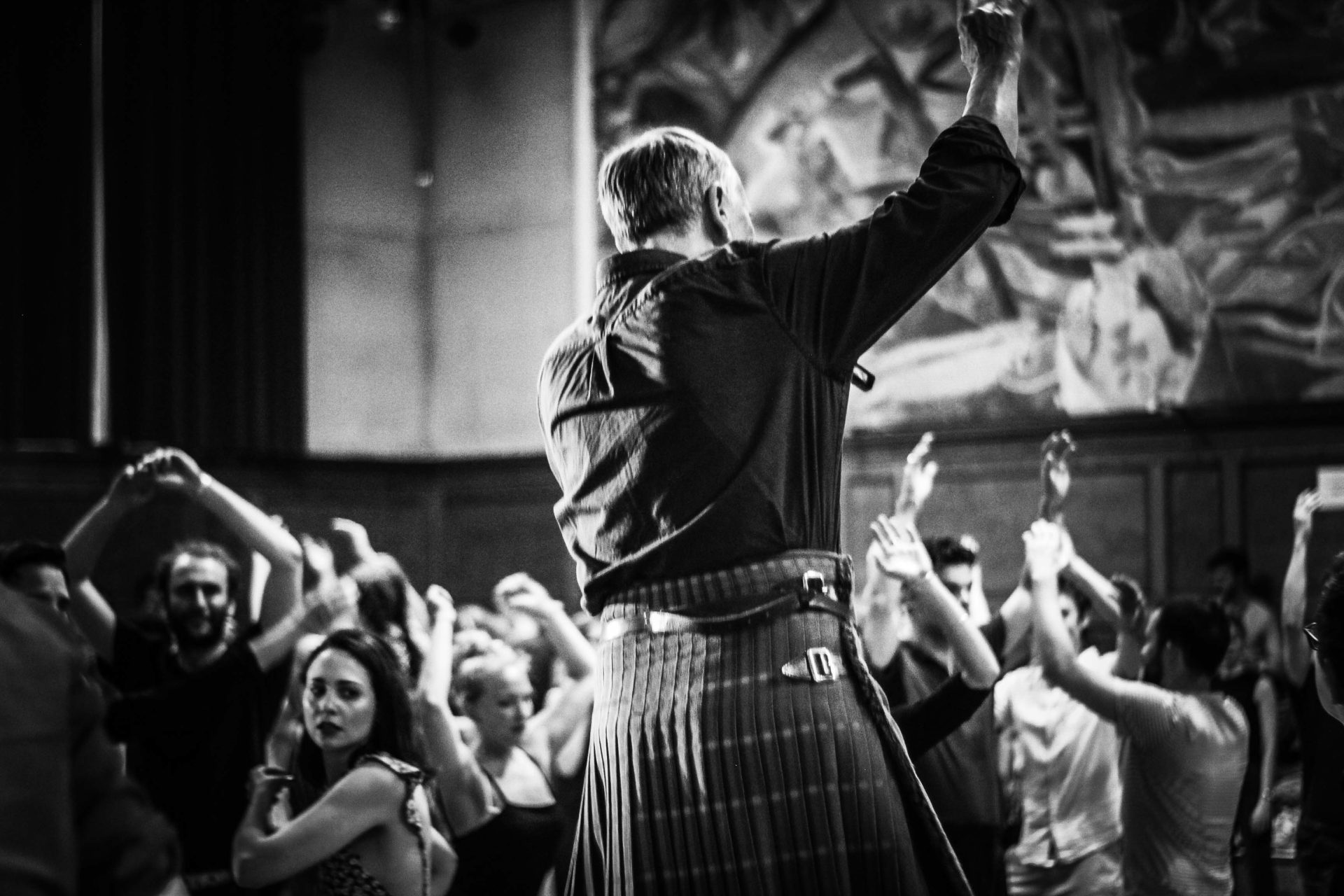 A man giving ceilidh instructions